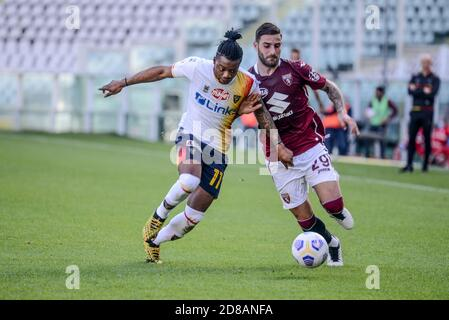 Nicola Murru of Torino FC and Claud Adjapong of US Lecce during the Coppa Italia football match between Torino FC and US Lecce at Olympic Grande Torin - Stock Photo