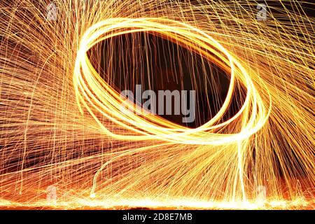 Fire spinning - Stock Photo
