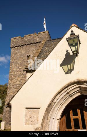 UK, Wales, Vale of Glamorgan, Llancarfan, St Cadoc's church porch with finger sundial - Stock Photo