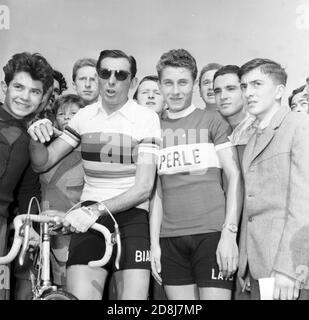 12th Baracchi Trophy (1953). The winner Fausto Coppi and Jacques Anquetil with the supporters---Milano, 04/11/1953. 12° Trofeo Baracchi. Nella foto: il vincitore Fausto Coppi (sin.) e Jacques Anquetil con i tifosi.