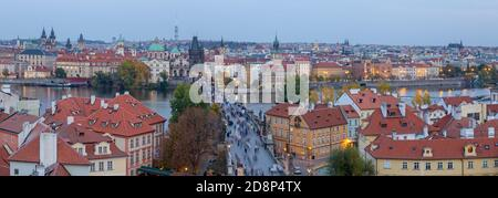 Prague - The panorama of the city with the Charles bridge and the Old Town at dusk.