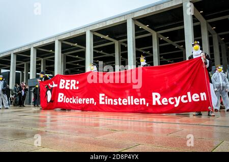 'BER: Blockieren, Einstellen, Recyclen' sign as climate activists protest against the opening of new Berlin Brandenburg (BER) Airport. - Stock Photo