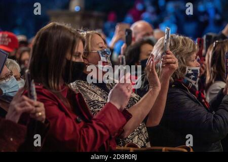 President Trump's supporters record videos of the U.S. First Lady Melania Trump remarks during the Make America Great Again campaign rally in Wapwallopen. - Stock Photo