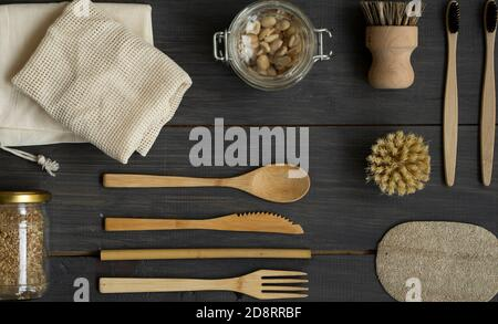 Zero waste kit. Set of eco friendly bamboo cutlery and cleaning brushes, mesh cotton bags, glass jars, loofah and bamboo toothbrushes. Natural and