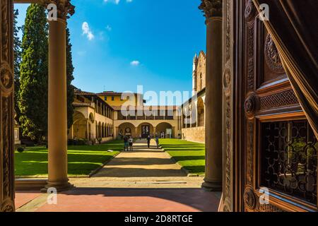 Picturesque view from the entrance of the Pazzi Chapel towards the first cloister, refectory and exit of the ecclesiastic complex of the Basilica di...