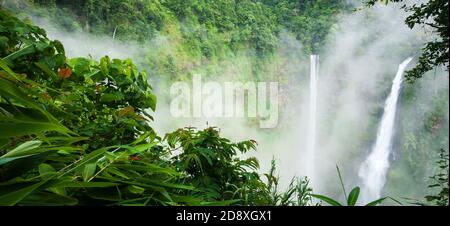 Wonderful Tad Fane waterfall in the morning mist, magical twin waterfalls in rain season, tourist attractions in South Laos.