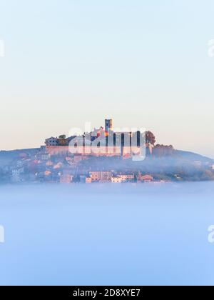 Like floating old town above thick fog stunning Motovun in Istria Croatia Europe in distance dreamy dreamland - Stock Photo