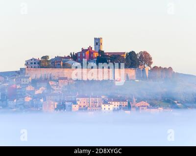 Like floating old town above thick fog stunning Motovun in Istra Istria Croatia Europe - Stock Photo