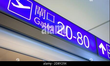 Hong Kong - April 9, 2015. Airport gates sign at Hong. kong Airport. Hong Kong International Airport is the Hong Kong's main airport.