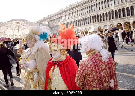 Piazza San Marco full of people that celebrate the Venice Carnival, in Italy, in February - Stock Photo