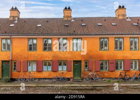 Copenhagen, Denmark - Historic yellow and orange coloured houses in the Nyboder neighborhood of Copenhagen, which was a former Naval di - Stock Photo