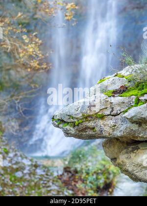 Big boulder rock balancing balance in Benkovski slap waterfall near Pican in Croatia Europe focus on rock - Stock Photo