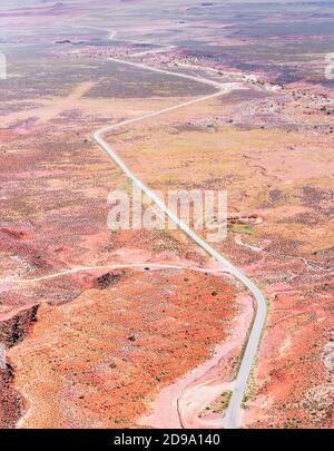 Winding roadway cutting through Valley of the Gods, Utah, USA,