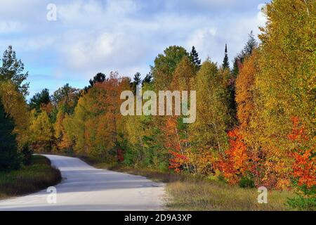 Paradise, Michigan, USA. Fall descends on a stretch of empty highway in the Upper Peninsula of Michigan.