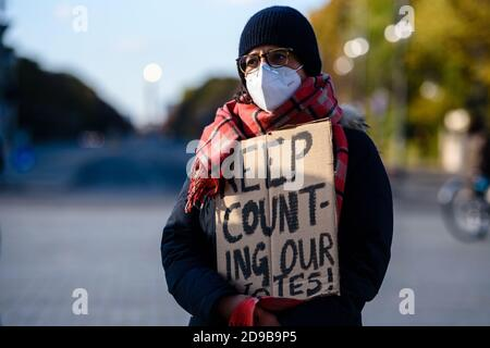 Germany, Berlin, November 04, 2020: A protesters and supporters of Democratic presidential candidate former Vice President JOE BIDEN holding a sign reading 'Keep counting our votes!' can be seen next to the Brandenburg Gate in Central Berlin during a rally unter the motto 'Count the Votes! Rally for Fair Elections in the USA' organized by the Democrats Abroad, the official organization of the Democratic Party for United States citizens living permanently or temporarily outside the United States, during the pending final vote count for the 2020 United States presidential election. The Organizer - Stock Photo
