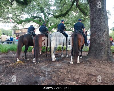 Baton Rouge, Louisiana, USA - 2019: Police officers on horses during a Live After Five free outdoors event, which includes live music and food trucks. - Stock Photo