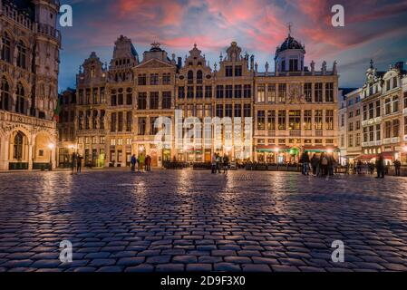 Sunset view over Grand Place with Hotel de Ville (City Hall) building, Brussels, Belgium