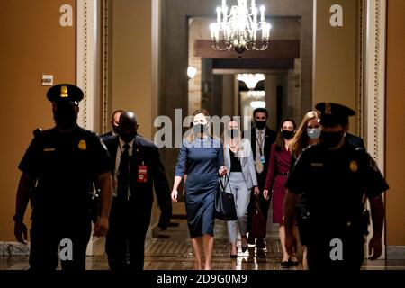 US Supreme Court Nominee Amy Coney Barrett departs a meeting with US Senate Majority Leader Mitch McConnell (R-KY) walks to the Senate Chamber at the US Capitol in Washington, DC, USA, 29 September 2020. Senators began meetings Barrett today ahead of her expected confirmation hearings in October. Credit: Alex Edelman/The Photo Access