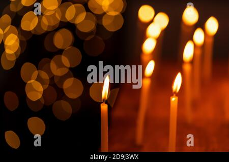 Beautiful candles lit during Diwali Festival creating light bokeh background, decorated on Dhanteras. Stock photo for holiday, festive celebration, ha