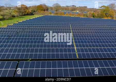 Aerial view of solar farm in welsh valleys. clean energy concept. drone shot - Stock Photo