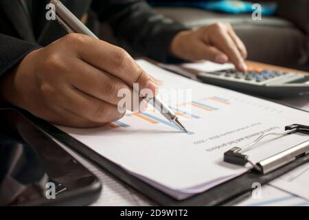 Business people reviewing reports, financial documents for analysis of financial information, work concept.