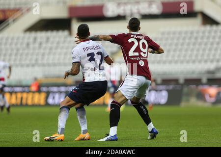 Pedro Pereira of FC Crotone  and Nicola Murru of Torino FC during the Serie A match between Torino FC and Crotone FC at Olympic Grande Torino Stadium - Stock Photo
