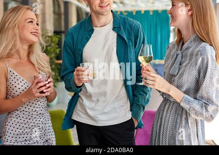 group of best friends having a great time in restaurant, celebrating birthday or corporate, they are chatting and drinking white wine