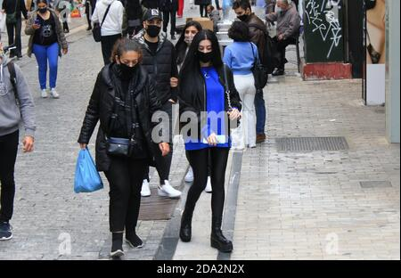 People walking at Ermou street in the center of Athens after the announcement for a second lockdown in Greece from 7th to 30th of November 2020, due t