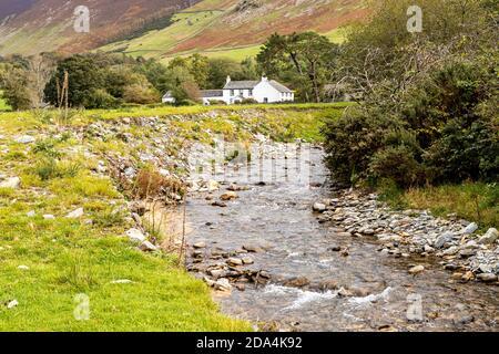 Low House & Liza Beck below Grisedale Pike in the English Lake District near Brackenthwaite, Cumbria UK