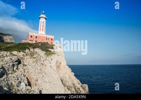 Seascape with a lighthouse on the coast and the sea. Capri island.