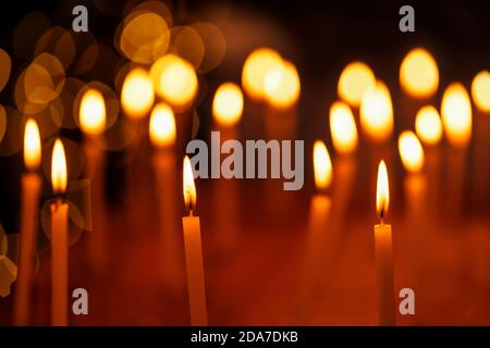 Beautiful group of candles lit during Diwali Festival night with light bokeh background. Concept for holiday, festive celebration, hanukkah, christmas