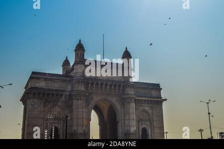 Beautiful Gateway of India near Taj Palace hotel on the Mumbai harbour with many jetties on Arabian sea near Chhatrapati Shivaji monument