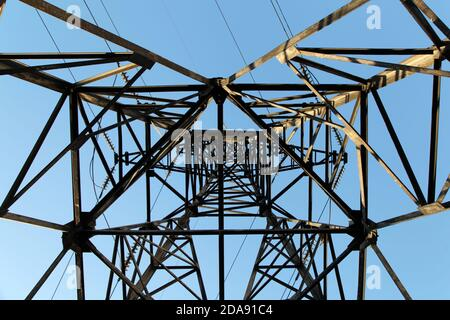 Electric power pylon and overhead lines tower used transmit electrical energy - Stock Photo