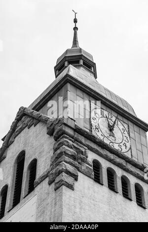 Qingdao / China - August 6, 2015: The bell tower of the Qingdao Protestant Church (Jidu jiaotang), built by German missionaries in 1910 when Qingdao ( - Stock Photo