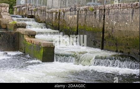 Fish ladder at Lopwell Dam, a weir on the River Tavy, Devon, England, UK. - Stock Photo