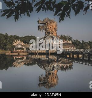 Hue, Vietnam, January 23, 2020, Dragon head in a abandoned Waterpark, Slide and swimming pool left behind, Hue, Vietnam