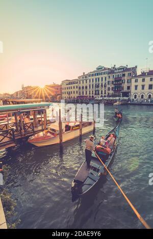09.21.19: Venice Grand canal with gondolas and Rialto Bridge, Italy. Amazing view from  Rialto bridge, famous travel destination, romantic vacation