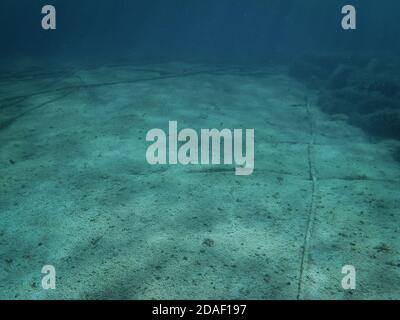 Underwater cables on the ocean floor in the Mediterranean Sea. - Stock Photo