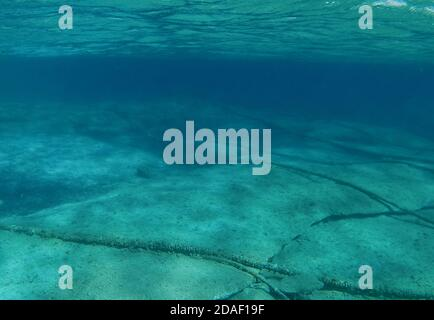 Underwater cables on the ocean floor in the Mediterranean Sea. - Stock Photo