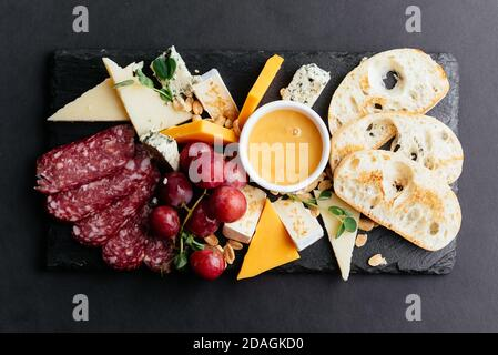 cheese and meat cuts on a black background