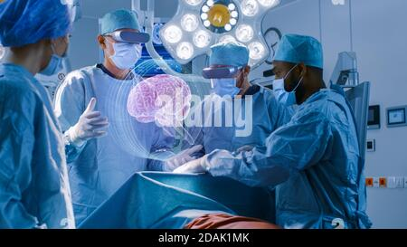 Surgeons Wearing Augmented Reality Glasses Perform Brain Surgery with Help of Animated 3D Brain Model, Using Gestures. High Tech Technologically - Stock Photo