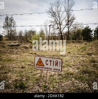 Ukraine. Chernobyl Exclusion Zone near Chernobyl nuclear power plant. Warning sign - Stop, exclusion zone, radioactivity