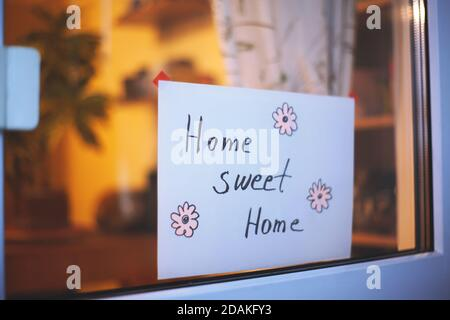 Childs Drawing Phrase Home, sweet home on white card. Handmade Board with Cute Cozy Text. Vintage Lettering House Design. Stay Home, Be Healthy