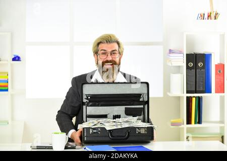 look at that. Businessman hand holding briefcase. suitcase with money. good deal. modern life and business. corporate leather bag. mature man with case at workstation. happiness and success. - Stock Photo