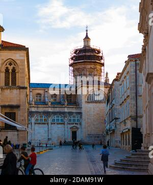 Dubrovnik Croatia November 2020 Town square are in front of the big church in the old city of Dubrovnik, people walking by and children playing in the - Stock Photo