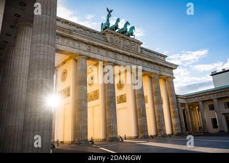 sun shining through brandenburg gate berlin germany