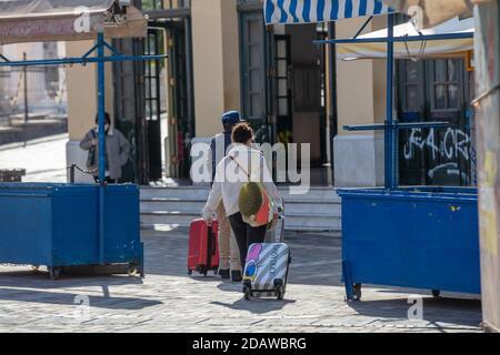 Athens, Greece. November 10, 2020. Monastiraki square, people entering metro station. Outdoor fruits market stall closed due to COVID 19 lockdown