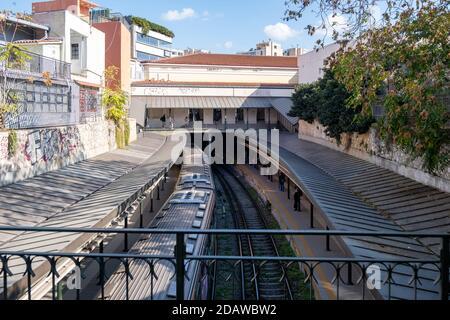 Athens, Greece. November 10, 2020. Monastiraki metro station, people waiting at the outdoor platform, wearing COVID 19 protective face masks, view fro