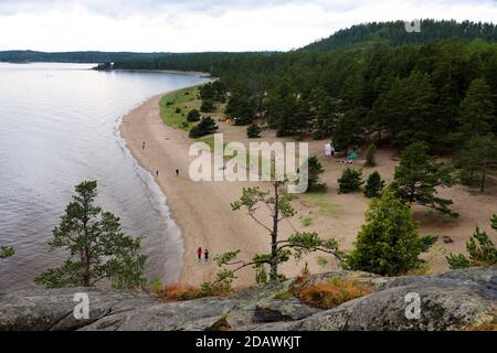 Beautiful lakeshore shoot from a high cliff and cloudy sky. Nature photography, landscape.