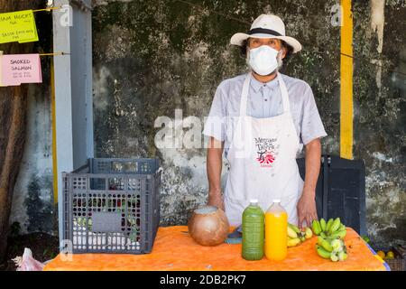 Man selling fruits and vegetables at the Slow food Farmers Market, Merida Mexico - during the Covid-19 Pandemic - Stock Photo